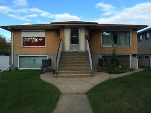 LARGE 1 BEDROOM BSMT SUITE- in 4 plex-FREE LAUNDRY,Central