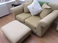 2 seater green sofa with accompanying footstool
