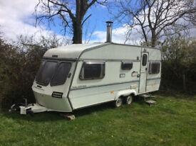 Lunar Delta 500 Caravan with wood burner