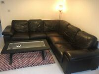 Brown leather corner sofa with matching coffee table