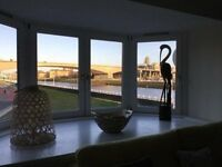 Stunning fully furnished city centre 2 bed / 2 bath river view apartment with secure parking