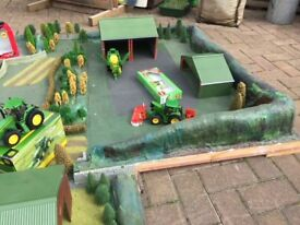 Hand Made toy farm with buildings, tractors and machinery