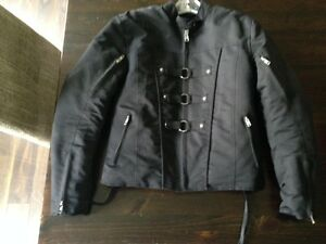 Women's motorbike jacket, helmet, and chaps for sale.
