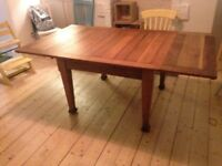 Antique oak extending dining table
