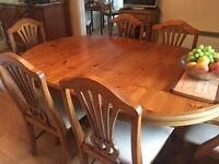 Polished modern pine table and six chairs