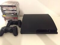 Sony PS3 slim 320GB with 2 Sony controllers and 12 games