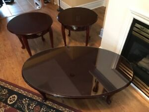 Coffee and end tables cherry wood for sale $350.00 for the set.