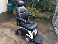 Travelux Venture battery powered wheelchair, with electric raise and lower seat