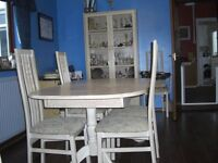 Extending Dining table and four chairs in Limed Oak