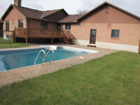 House with large yard and inground pool in the country