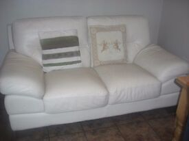 As new, excellent condition, exceptional quality - large 2 seater settee with four dark wood feet.