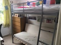 top bunk bed, grey metal with seating area underneath