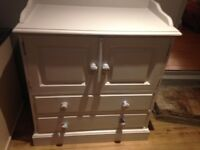 Baby changing unit with cupboard and drawers