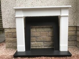 Wooden fire surround with slate hearth and slip