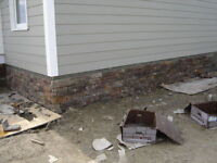 Exterior stucco and stone repairs