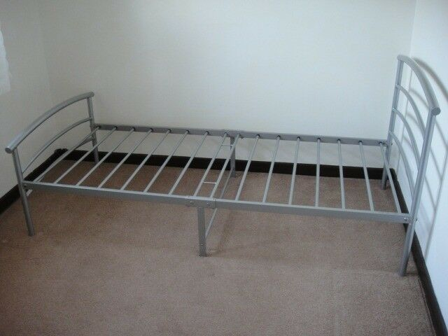 Complete single bed with metal frame, mattress and