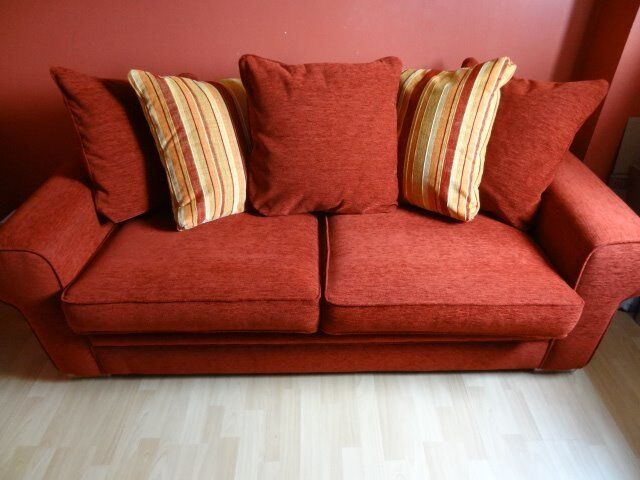 Sofa Bed, Including 5 x cushions. Red, Very Good Conditionin Arbroath, AngusGumtree - Sofa Bed, Fold down sofa bed in very good condition. There are two large seating cushions but its actually a three seater. It also has 5 x back cushions, 3 are red and 2 are red, orange and yellow. Originally bought from SCS and cost around £850.00....