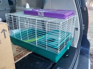 small pet cage and a number of small pet litterboxes