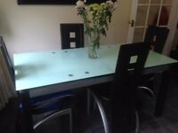 Extending glass top dining table