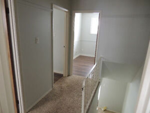one month rent free - 3 bedroom plus den half duplex