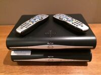 2 x Sky boxes with viewing cards and remote controls for sale. Good condition. No power cables