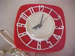 VINTAGE GENERAL ELECTRIC RED AND WHITE WALL HANGING ELECTRIC CLOCK