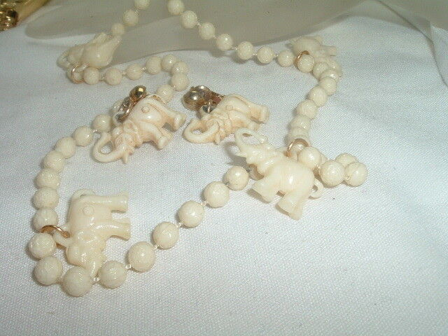 VINTAGE CELLULOID ELEPHANT NECKLACE AND CLIP EARRINGS SET