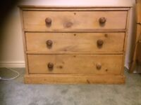 Antique pine three-drawer chest-of-drawers