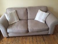 Beige comfy two seater sofa for sale
