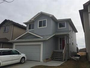 Half Duplex with Modern Elegance in Lake Community!