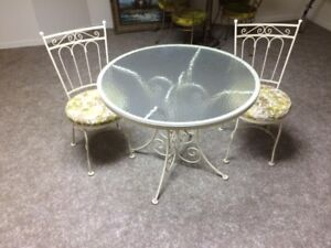 glass top round table and 2 chairs