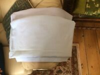 two pale blue flat double sheets