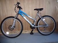 Ladies Mountain Bike- Shimano gears, front disk brake and shock absorbers Used a handful of times!
