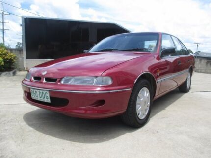 1995 Holden Commodore VS Executive Masai Red 4 Speed Automatic Sedan Birkdale Redland Area Preview