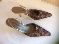 Roland Cartier gold heeled shoes