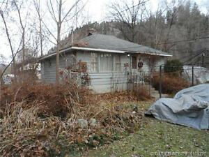 Large level .47 acre residential lot with 2 bed/1 bath home