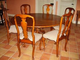 Solid oak table and six dining chairs