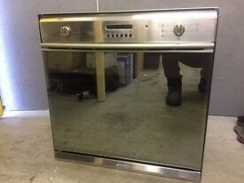 Smeg Integrated Electric Fan Oven- VGC- 60cm Wide- Mirrored Front.