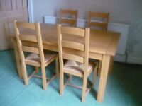 Oak dinning table with 4 ladder back chairs.