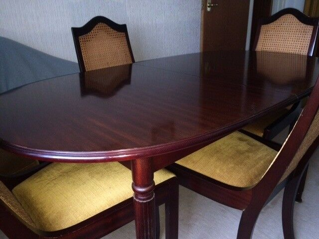 Dining table and chairs, wall unit and legged sideboard