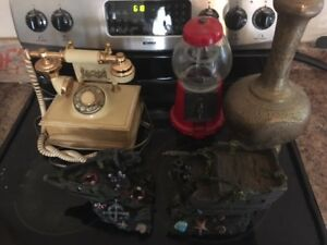 Old phone , brass vase, gumball machine and pirate ship