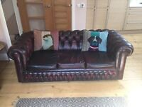 Pair of oxblood Chesterfield sofas