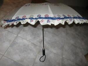 ...A POP-UP UMBRELLA...with FRILLS...YOUTH-SIZE!