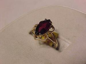 #1122-Cute garnet dress ring    Just $145.00 size 5 1/2--FREE SHIPPING AND LAYAWAY IN CANADA ONLY-