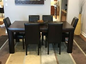 Modern dining room set with rug