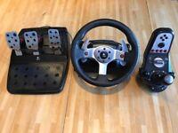 Logitech G25 steering wheel inc pedals & gearshift.