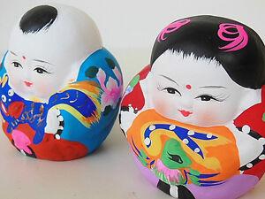 Oriental Pottery Couple Figurine Set