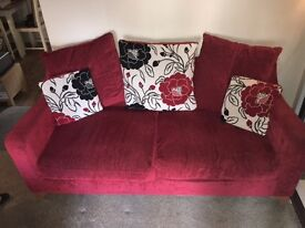 two seater sofa,,red with scatter cushions can be bought as a pair as we have two