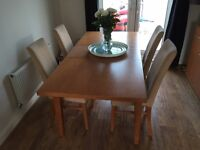 Extending cherry dining table with 6 chairs and matching sideboard