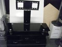 TV Stand with drawers . Black color . Glass top .